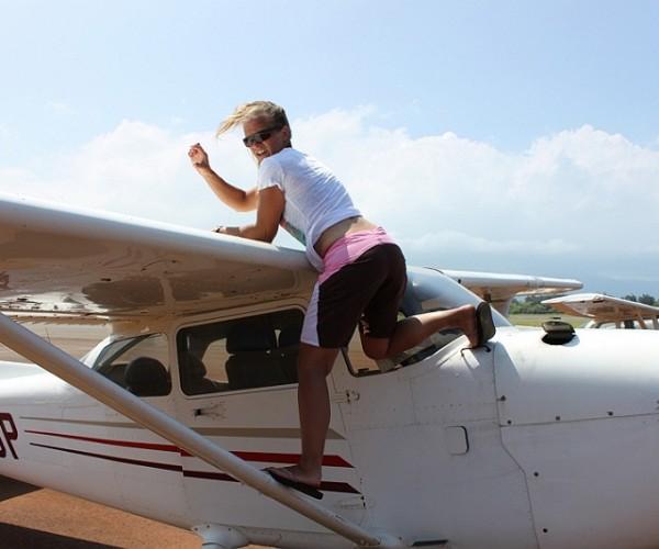 Jule pre-flighting her airplane
